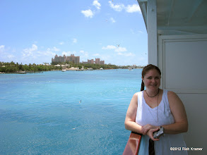 Photo: Amy on our balcony as we docked in Nassau.  The Atlantis resort is in the background.
