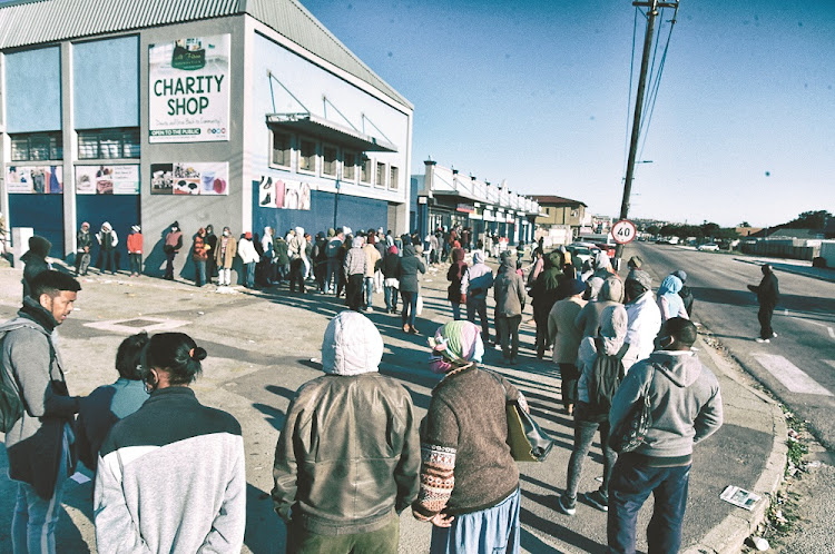 Early and desperate: People began queuing at 4am this week at the post office in Durban Road, Port Elizabeth, to collect their R350 unemployment grants. Picture: The Herald/Eugene Coetzee