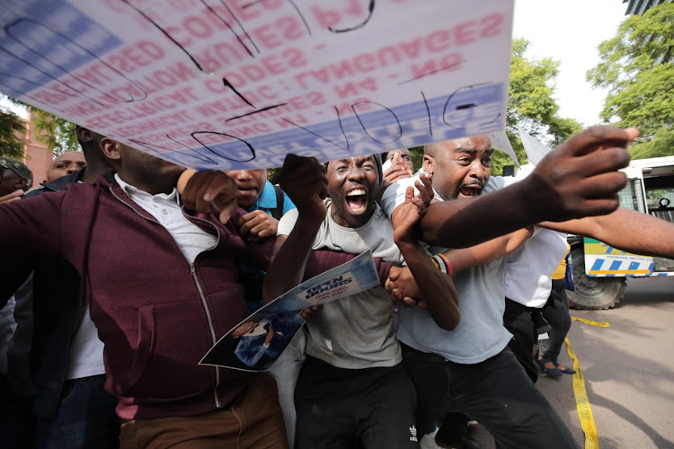 Supporters of self-proclaimed prophet Shepherd Bushiri celebrate outside the Pretoria Specialised Commercial Crimes Court on February 6 2019. Bushiri and his wife Mary, who have been accused of money laundering and fraud, were granted bail of R100,000 each.