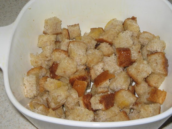 Place the cubes in the prepared baking dish and drizzle the melted butter them.Toss...