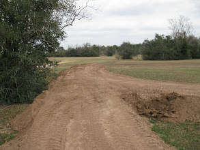 Photo: Phase IV Right of Way at the end of the work day after widening and raising the far end.