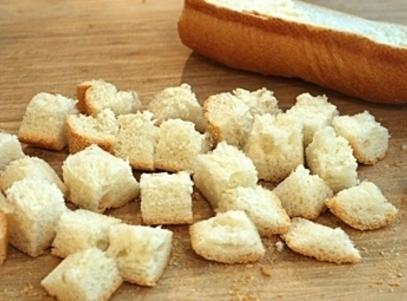 Allow bread cubes to dry out overnight, or dry them on a baking sheet...
