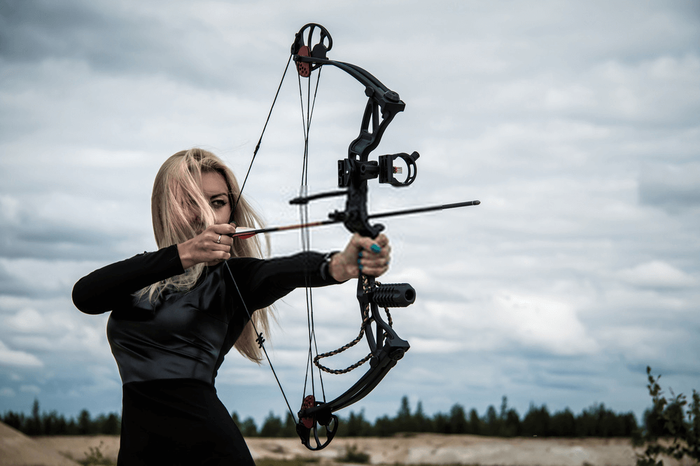 person shooting compound bow