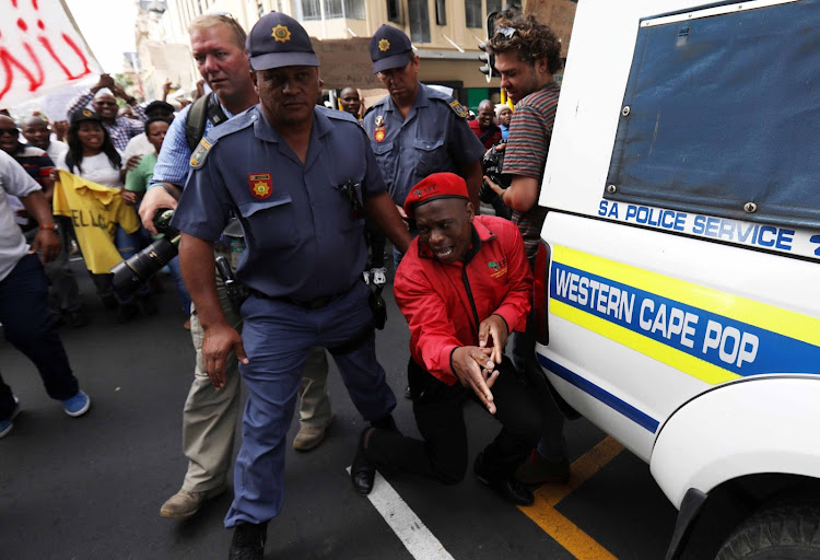Striking police officers marched to parliament under the banner of the SA Police and Allied Workers Union over a list of grievances as hundreds skipped work in Western Cape on Tuesday.