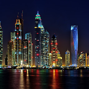 Dubai Marina by RJ Ramoneda - City,  Street & Park  Vistas ( water, building, night, marina, hotels )