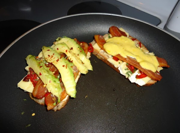 Top with bacon slices and avocado. Salt and pepper to taste and add red...