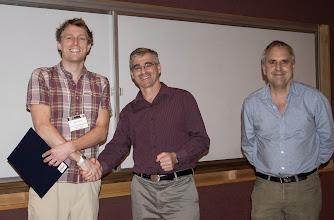 Photo: John Duchi accepting the C.V. Ramamoorthy Distinguished Research Award.