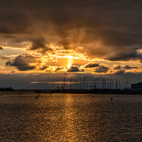 Behind Clouds by John Goff - Landscapes Sunsets & Sunrises ( annapolis city dock sunrise )