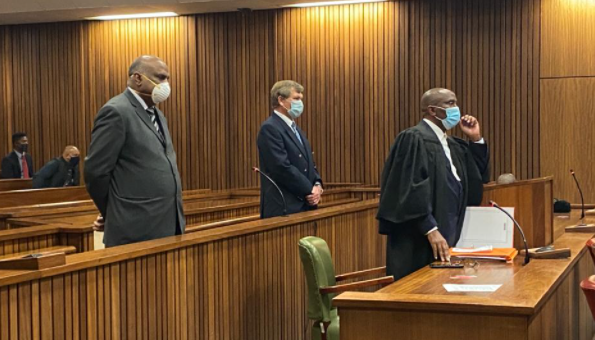 Richard Mdluli's co-accused, Heine Barnard and Solomon Lazarus, appeared in the high court in Pretoria without him on Monday.