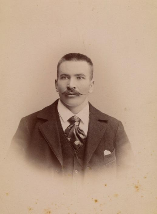 A person wearing a suit and tieDescription automatically generated