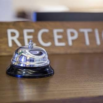bell on reception desk at hotel