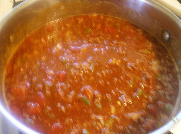 Add beer, canned tomatoes and juice,ketchup, and coffee.  Turn heat down and simmer...