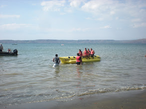 """Photo: Playa Panama - west of Liberia is more like a lake - with just one small outlet from the bay.  Danna and Erin hop on the """"banana boat"""""""