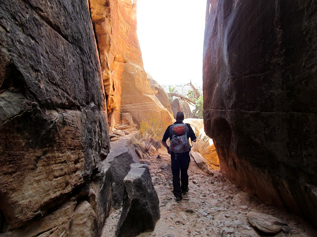 Walking between huge sandstone blocks