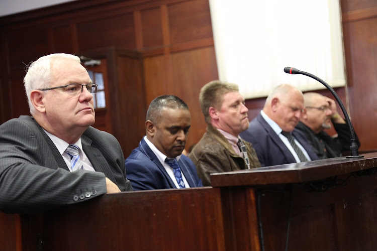 Former Hawks boss Johan Booysen in the doc with his fellow accused in the Durban High Court.