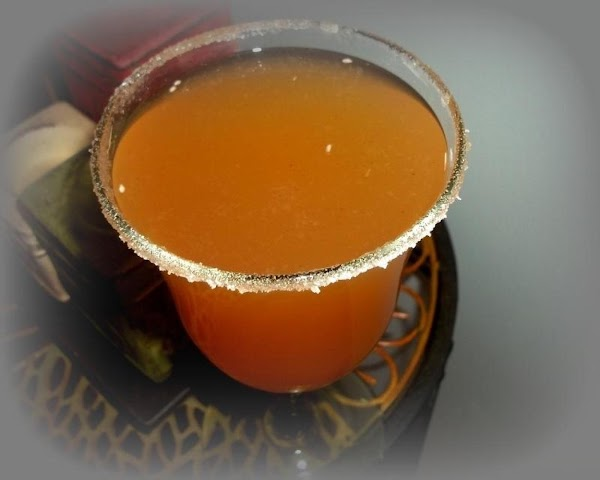 Mix, rum, simple syrup, cider, dash cinnamon, lime juice. Shake with some ice.  Place some...