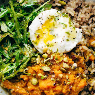 Healing Bowls with Turmeric Sweet Potatoes, Poached Eggs, and Lemon Dressing.