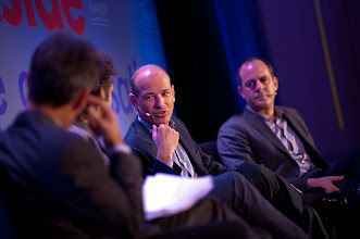 """Photo: Howard Gordon (center) comments during the """"Hollywood and Policy"""" panel discussion Friday, Nov. 16 at the RAND Politics Aside event in Santa Monica as fellow panelist David Nevins looks on."""
