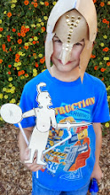 Photo: Max with his Greek helmet and hinged shadow puppet!