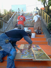 Photo: Third full day of work (October 29, 2013) with KZ Tile workers (Sing in red shirt, Henry in white shirt, Ton in blue shirt) installing the first sections of the Hidden Garden Steps (16th Avenue, between Kirkham and Lawton streets in San Francisco's Inner Sunset District) 148-step ceramic-tile mosaic designed and created by project artists Aileen Barr and Colette Crutcher. For more information about this volunteer-driven community-based project supported by the San Francisco Parks Alliance, the San Francisco Department of Public Works Street Parks Program, and hundreds of individual donors, please visit our website at http://hiddengardensteps.org.