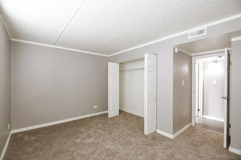Daisy floorplan bedroom with carpet and large closet