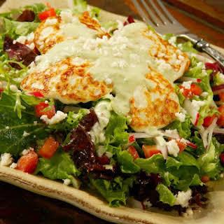 Baby Green Salad with Seared Panela and Avocado Vinaigrette.