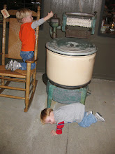 Photo: Day 5 - Big brother convinced little brother he needed to lay down on the ground to let him know if he could hear the motor sounds from the turning of the handle :-)