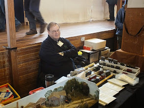 Photo: 009 Howard Martin, proprietor of the Avalon Models range of 7mm scale resin kits and exhibition manager of NGSW, looking suitably relieved that he has managed to get to the start of the show safely again .