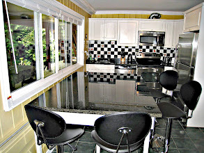 Photo: GARDEN LEVEL KITCHEN HAS A LARGE EATING ISLAND WITH 4 BAR-STOOLS