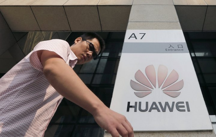 A man walks past a Huawei company logo outside the entrance of a Huawei office in Wuhan, Hubei province. Picture: REUTERS