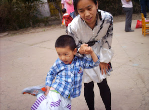 Photo: old photos from emakingir: baby son and his mom, emakingir, in kindergarten's party.