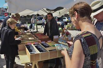 Photo: Postcard vendor - Labastide-Murat brocante (antique/flea market)