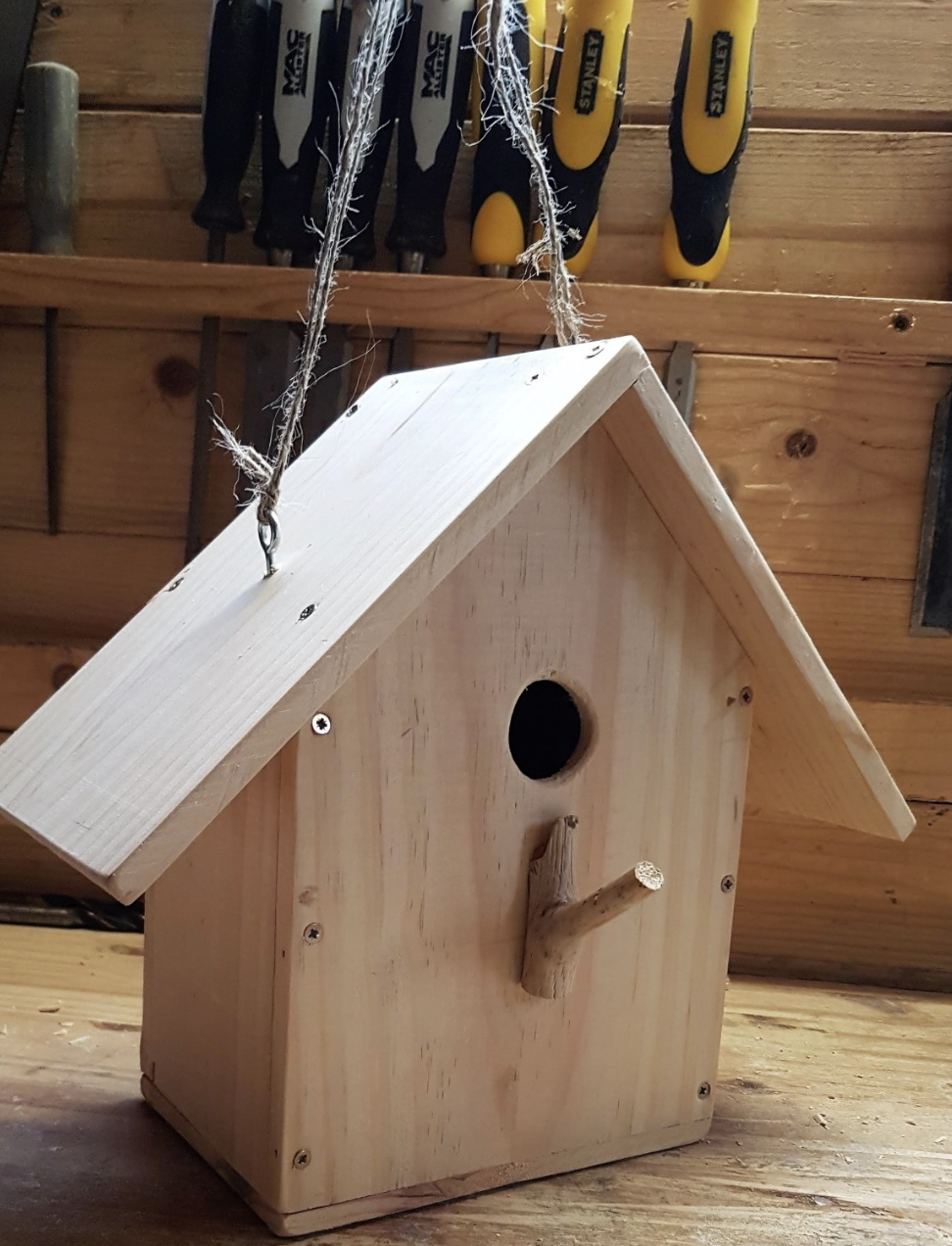 Add string to the bird feeder so you can hang it