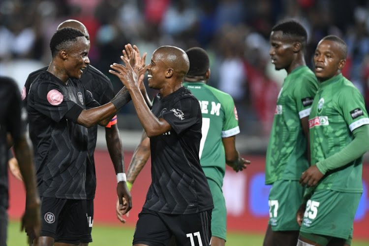 Luvuyo Memela of Orlando Pirates celebrates his goal with Kudakwashe Mahachi during the Absa Premiership match between Orlando Pirates and AmaZulu FC at Orlando Stadium on February 23, 2019 in Johannesburg, South Africa.