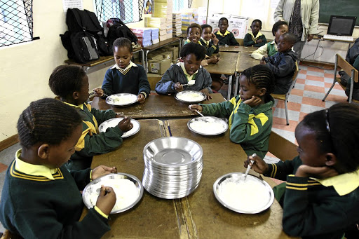 A healthy body and mind: Grade 3 pupils from Mdantsane's Vulumzi Primary School enjoy a meal as part of the education department's feeding scheme to make up for poor nutrition. Picture: MARNÉ ERASMUS