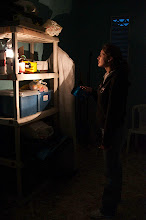 Photo: The Dominican Republic experiences extremely frequent power outages, Ana Ries uses a flashlight until they can get the generator up and running.