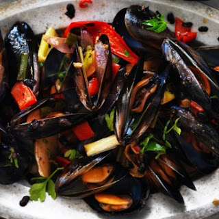 Kylie Kwong's stir-fried mussels with black beans, chilli and native herbs.