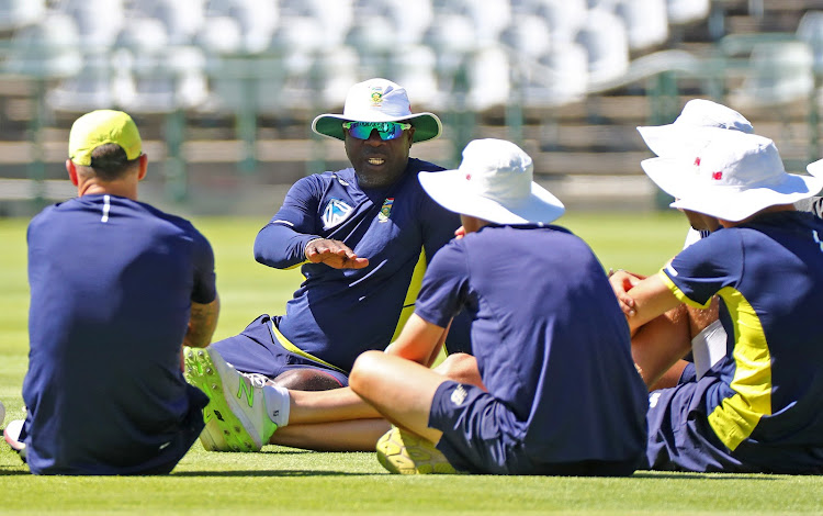SA senior men's national cricket team head coach Ottis Gibson in a discussion with the players during the Proteas training session .