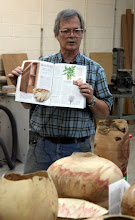 Photo: David shows his article in the Feb. 2003 issue of the prestigious Brit magazine Fine Woodworking.