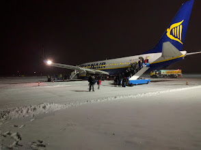 Photo: Walking across the snow to the plane.