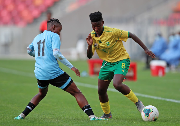 Banyana's Sibulele Cecilia Holweni, seen here dribbling Lone Gaofetoge of Botswana during the Cosafa final, had to dribble past her mom to play the game.