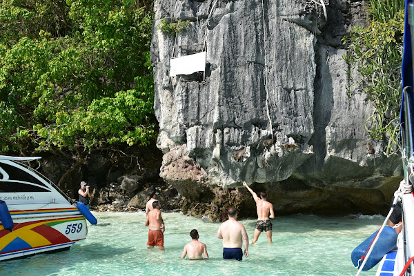 Stop at Monkey Beach located on the southwestern side of Tonsai Bay