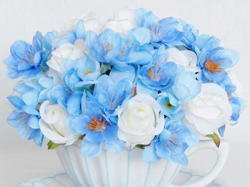 Beauty everlasting silk floral my spotlight this week is on teacup silk floral arrangements this one is pretty white mini roses and periwinkle blue fanciful flowers in a very pretty mightylinksfo