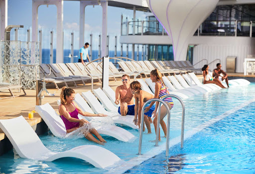 Celebrity-Edge-pool.jpg - The pretty main pool on Celebrity Edge class ships holds appeal to families and to anyone who wants to swim laps.