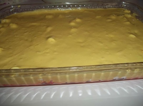 Prepare the cake mix as directed on the package, and pour on top of...
