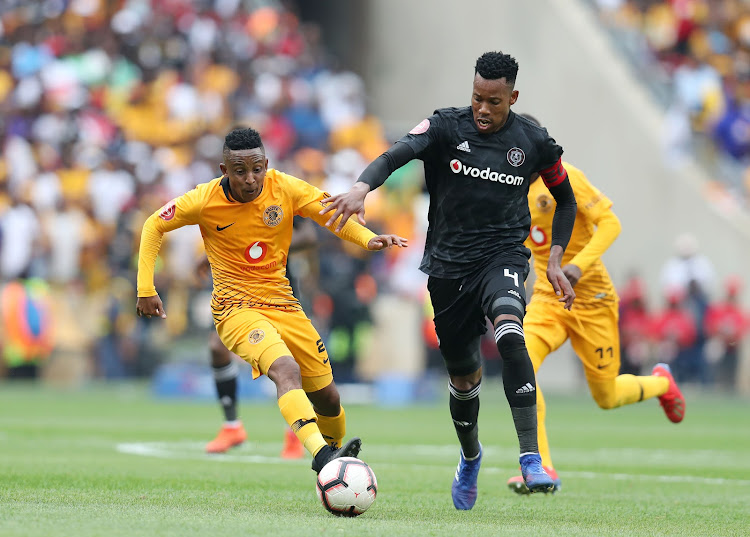 Kaizer Chiefs midfielder Pule Ekstein (L) challenges Orlando Pirates defender and captain Happy Jele (R) during the 1-1 Absa Premiership Soweto derby draw at FNB Stadium on February 9 2019.