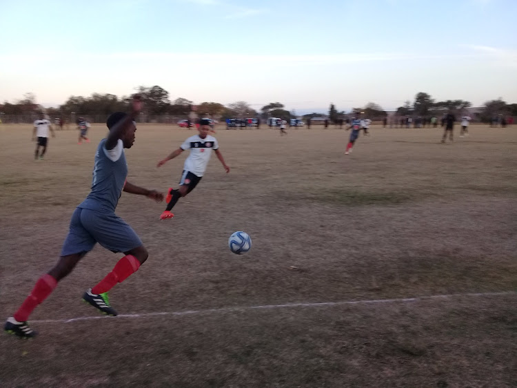 Manchester United's midfielder Thamsanqa Mbambosi tries to steal the ball from problematic Amavarara striker Brandon Jackson during their 1-all draw at the Army Base in Grahamstown today