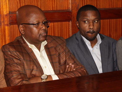 Former NHIF CEO Geoffrey Mwangi (R) and finance director Wilbert Kurgat at the Milimani law court on Monday, November 26, 2018.