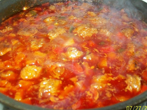 At this point you'll want to add the tomato sauce, vinegar, honey, peppers, salt,...