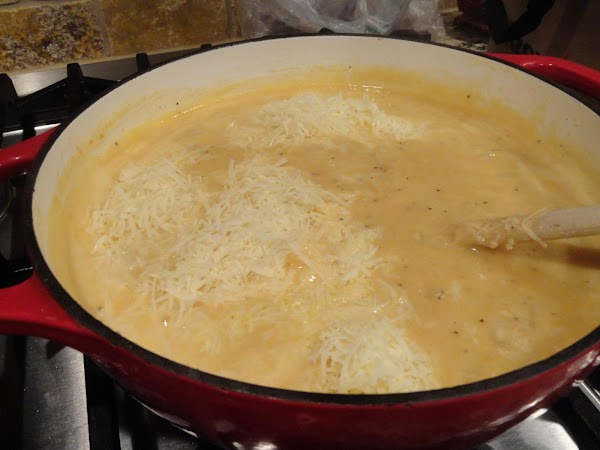 Slowly stir in chicken stock, cream, and milk stirring out any lumps. Add salt...